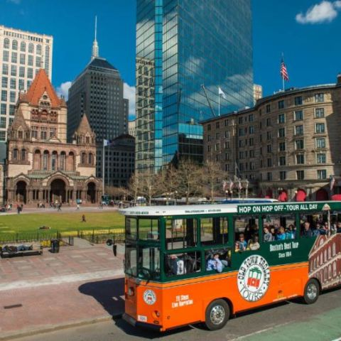 Trolley tour bus leaving Battery Wharf Hotel Boston Waterfront